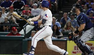 Texas Rangers' Nick Solak watches his two-run home run, next to Tampa Bay Rays catcher Mike Zunino during the fourth inning of a baseball game in Arlington, Texas, Thursday, Sept. 12, 2019. (AP Photo/Tony Gutierrez)