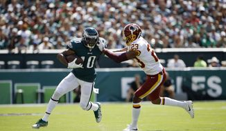 Philadelphia Eagles' DeSean Jackson, left, tries to break free of Washington Redskins' Quinton Dunbar during the first half of an NFL football game, Sunday, Sept. 8, 2019, in Philadelphia. (AP Photo/Matt Rourke) ** FILE **