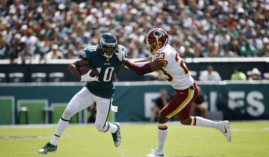 Philadelphia Eagles' DeSean Jackson, left, tries to break free of Washington Redskins' Quinton Dunbar during the first half of an NFL football game, Sunday, Sept. 8, 2019, in Philadelphia. (AP Photo/Matt Rourke) ** FILE **