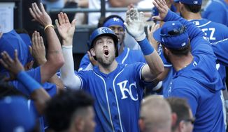 Kansas City Royals' Hunter Dozier celebrates in the dugout his three-run home run off Chicago White Sox starting pitcher Lucas Giolito during the sixth inning of a baseball game Thursday, Sept. 12, 2019, in Chicago. Jorge Soler, and Whit Merrifield also scored. (AP Photo/Charles Rex Arbogast)