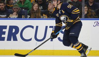 FILE - In this March 14, 2019, file photo, Buffalo Sabres defenseman Rasmus Ristolainen (55) looks to pass during the second period of an NHL hockey game against the Pittsburgh Penguins, in Buffalo N.Y. Ristolainen says he's happy to report for the start of training camp despite offseason suggestions he'd prefer a change of scenery. What Ristolainen declined to say Thursday, Sept. 12, 2019, was whether he'd still be happy being in Buffalo in March following the NHL's trading deadline.(AP Photo/Jeffrey T. Barnes, File)