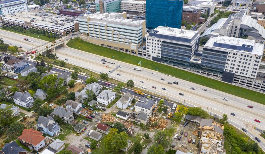 This aerial photo shows significant storm damage in Grand Rapids, Mich.,  on Thursday, Sept. 12, 2019.  Severe thunderstorms on Wednesday,  brought heavy rain, high winds, damaging buildings and leaving tens of thousands without power.   (Cory Morse/The Grand Rapids Press via AP)