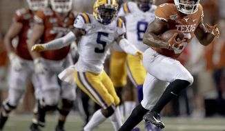 Texas wide receiver Devin Duvernay (6) runs for a touchdown against LSU during an NCAA football game on Saturday, Sept. 7, 2019, in Austin, Texas. (Nick Wagner/American-Statesman via AP)