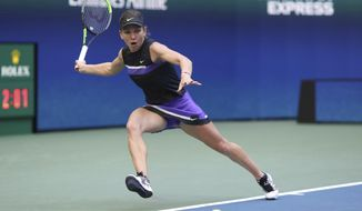 Simona Halep, of Romania, chases down a shot from Taylor Townsend, of the United States, during the second round of the US Open tennis championships Thursday, Aug. 29, 2019, in New York. (AP Photo/Kevin Hagen)