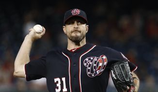 Washington Nationals starting pitcher Max Scherzer throws to the Atlanta Braves during the first inning of a baseball game Friday, Sept. 13, 2019, in Washington. (AP Photo/Patrick Semansky)