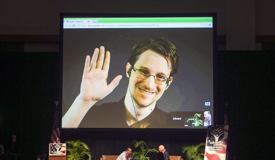 In this Feb. 14, 2015, file photo, Edward Snowden appears on a live video feed broadcast from Moscow at an event sponsored by ACLU Hawaii in Honolulu. Snowden has written a memoir, telling his life story in detail for the first time and explaining why he chose to risk his freedom to become perhaps the most famous whistleblower of all time. (AP Photo/Marco Garcia, File)