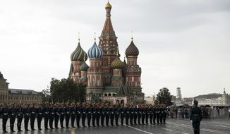 FILE - In this June 30, 2018, file photo, Kremlin guards perform in Red Square with the with St. Basil's Cathedral in the background, in Moscow, Russia. A negotiating team from the Taliban arrived Friday, Setp. 13, 2019, in Russia, a representative said, just days after U.S. President Donald Trump declared dead a deal with the insurgent group in Afghanistan. (AP Photo/Pavel Golovkin, File)