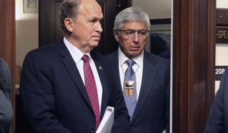 FILE - In this Thursday, Jan. 18, 2018 file photo, Alaska Gov. Bill Walker, left, and Lt. Gov. Byron Mallott wait for a joint session of the Alaska Legislature to convene in Juneau, Alaska.An email from Alaska's former first lady sheds new light on the actions that drove Lt. Gov. Byron Mallott from office, suggesting he may have invited a woman into his room, newly released emails shows. (AP Photo/Mark Thiessen, File)