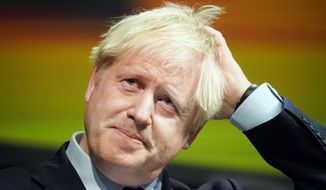 Britain's Prime Minister Boris Johnson makes a speech at the Convention of the North at the Magna Centre in Rotherham, England, Friday, Sept. 13, 2019. Johnson will meet with European Commission president Jean-Claude Juncker for Brexit talks Monday in Luxembourg. The Brexit negotiations have produced few signs of progress as the Oct. 31 deadline for Britain's departure from the European Union bloc nears. (Christopher Furlong/Pool photo via AP)