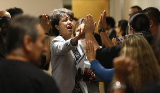 State Sen. Connie Leyva, D-Chino, gets high-fives from supporters of ACA14 who packed the hallway of the Capitol in Sacramento, Calif., Friday, Sept. 13, 2019. ACA14 would place an amendment on the 2020 ballot requiring the University of California to give contract workers the same equal opportunity standards as employees. (AP Photo/Rich Pedroncelli)