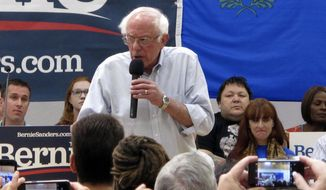 "Sen. Bernie Sanders, I-Vt., talks to several hundred people while campaigning for president at a town hall meeting at the Carson City Convention Center, Friday, Sept. 13, 2019, in Carson City, Nev. He said former Vice President Joe Biden is distorting Sanders' ""Medicare for All"" health care plan. (AP Photo/Scott Sonner)"