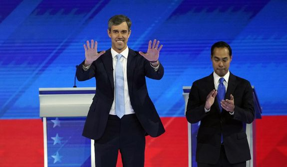 Former Texas Rep. Beto O'Rourke, left, and former Housing and Urban Development Secretary Julian Castro, right, take the stage Thursday, Sept. 12, 2019, during a Democratic presidential primary debate hosted by ABC at Texas Southern University in Houston. (AP Photo/David J. Phillip)