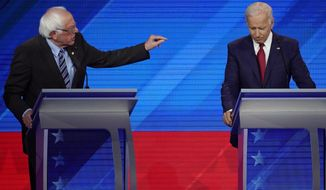 Sen. Bernie Sanders, I-Vt., left, speaks as former Vice President Joe Biden, right, listens Thursday, Sept. 12, 2019, during a Democratic presidential primary debate hosted by ABC at Texas Southern University in Houston. (AP Photo/David J. Phillip)
