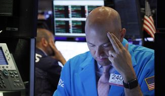 FILE - In this Aug. 23, 2019, file photo specialist Jay Woods, right, works on the floor of the New York Stock Exchange. The U.S. stock market opens at 9:30 a.m. EDT on Friday, Sept. 13. (AP Photo/Richard Drew, File)