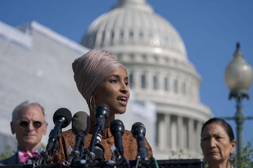 In this July 25, 2019, file photo, Rep. Ilhan Omar, D-Minn., center, flanked by Rep. Earl Blumenauer, D-Ore., left, and Rep. Deb Haaland, D-N.M., introduces the Zero Waste Act that would create a federal grant program to help local governments invest in waste-reduction initiatives, at the Capitol in Washington. (AP Photo/J. Scott Applewhite, File)