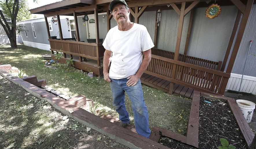 ADVANCE ON THURSDAY, SEPT. 12 FOR USE ANY TIME AFTER 3:01 A.M. SUNDAY SEPT 15 - In the Aug. 31, 2019, photo Dave Bray resident of the a mobile home park on Animas View Drive poses for a picture in Durango, Colo. Bray plans to move out of the park following lot rent increases since 2015. Rising lot rents at some of the large mobile home parks in La Plata County are pushing out longtime residents. (Jerry McBride/Durango Herald via AP)