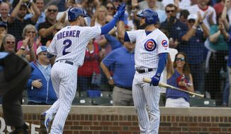 Chicago Cubs' Nico Hoerner (2) celebrates with teammate David Bote right, after hitting a two-run home run during the first inning of a baseball game against the Pittsburgh Pirates, Friday, Sept. 13, 2019, in Chicago. (AP Photo/Paul Beaty)