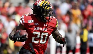 Maryland Terrapins running back Javon Leake (20) runs the ball during the first half of an NCAA college football game against the Syracuse Orange, Saturday, Sept. 7, 2019, in College Park, Md. (AP Photo/Will Newton)