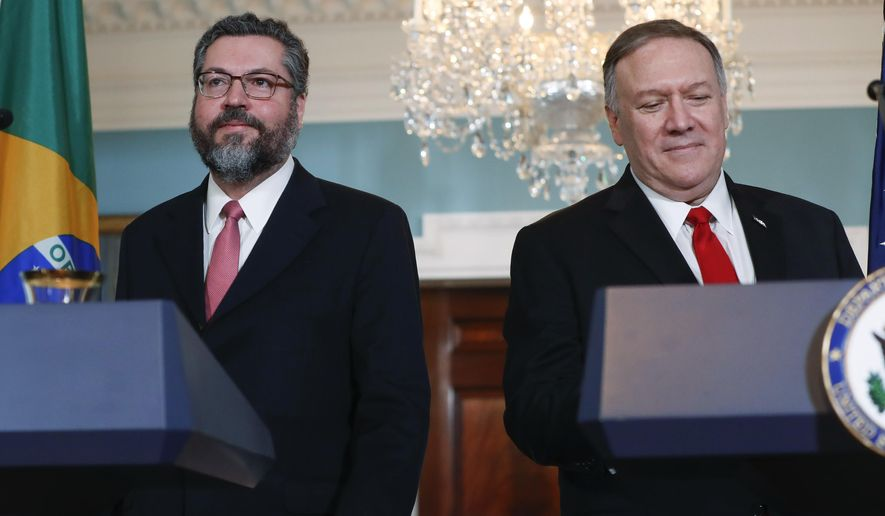 Secretary of State Mike Pompeo, right, and Brazilian Foreign Minister Ernesto Araujo, left, walk out to deliver remarks to members of the media at the Department of State in Washington, Friday, Sept. 13, 2019. (AP Photo/Pablo Martinez Monsivais)
