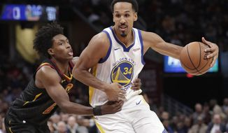 FILE - In this Dec. 5, 2018, file photo, Golden State Warriors' Shaun Livingston (34) drives past Cleveland Cavaliers' Collin Sexton (2) in the second half of an NBA basketball game in Cleveland. Livingston announced his retirement Friday, Sept. 13, 2019, following 15 NBA seasons, an expected move. (AP Photo/Tony Dejak, File)