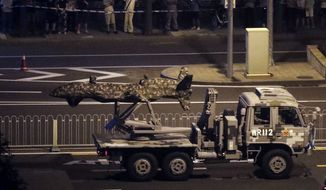 The DR-8 drone, covered in a camouflage tarp on a flatbed truck, was seen for the first time in photographs published on Chinese social media. (Associated Press/File)