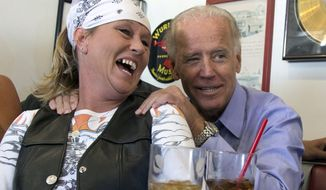 FILE - In this Sept. 9, 2012, file photo, Vice President Joe Biden visits with patrons over lunch at Cruisers Diner in Seaman, Ohio. Famous for his off-the-cuff storytelling, the former vice president regularly goes deep in the vault to pull out characters and events known only to a people of a certain age. (AP Photo/Carolyn Kaster, File)