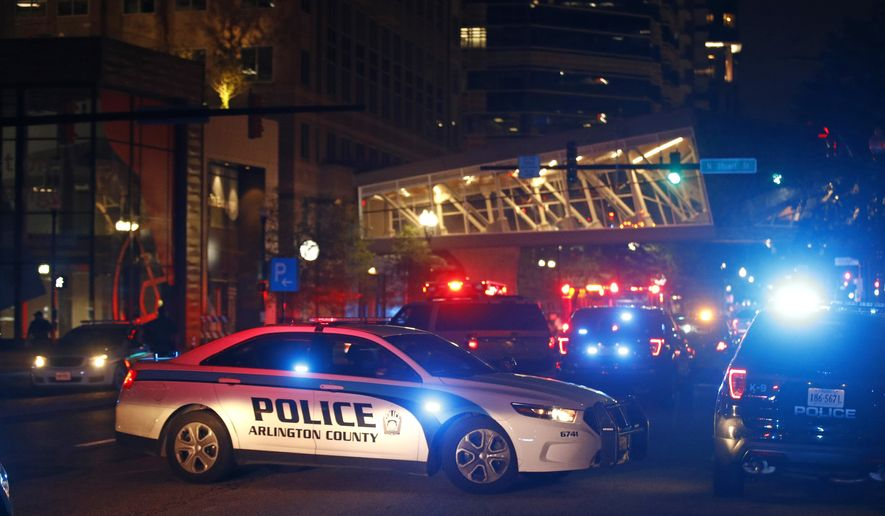Law enforcement officials respond to reports of a shooting at Ballston Quarter mall in Arlington, Va., Saturday, Sept. 14, 2019. Authorities said they have found no evidence that a shooting occurred at a movie theater that is part of the mall. Reports of a shooting had prompted panic and a large police presence Saturday night. (AP Photo/Patrick Semansky)