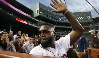 Former Boston Red Sox's David Ortiz waves to the crowd after throwing out a ceremonial first pitch before a baseball game against the New York Yankees in Boston, Monday, Sept. 9, 2019. (AP Photo/Michael Dwyer)