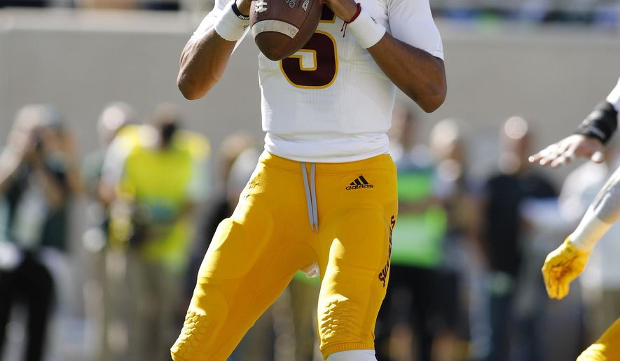 Arizona State quarterback Jayden Daniels looks to throw against Michigan State during the first quarter of an NCAA college football game Saturday, Sept. 14, 2019, in East Lansing, Mich. (AP Photo/Al Goldis)