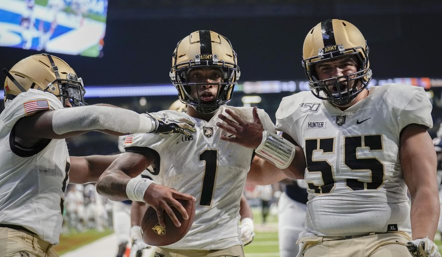 Army quarterback Jabari Laws (1) celebrates with teammates J.B. Hunter (55) and Kell Walker after running for a touchdown during the second half of an NCAA college football game against UTSA on Saturday, Sept. 14, 2019 in San Antonio. (AP Photo/Darren Abate)