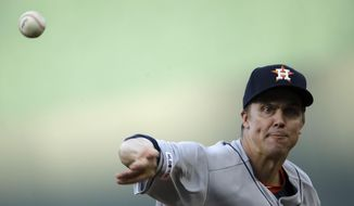 Houston Astros starting pitcher Zack Greinke throws during the first inning of the team's baseball game against the Kansas City Royals on Saturday, Sept. 14, 2019, in Kansas City, Mo. (AP Photo/Charlie Riedel)