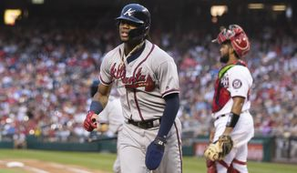 Atlanta Braves Ronald Acuna Jr., runs back to their dugout after scoring a run during the seventh inning of a baseball game against the Washington Nationals in Washington, Saturday, Sept. 14, 2019. (AP Photo/Manuel Balce Ceneta)