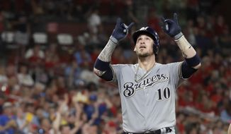 Milwaukee Brewers' Yasmani Grandal celebrates as he arrives home after hitting a two-run home run during the eighth inning of a baseball game against the St. Louis Cardinals, Saturday, Sept. 14, 2019, in St. Louis. (AP Photo/Jeff Roberson)