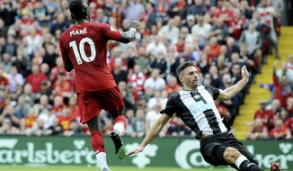 Liverpool's Sadio Mane, left, after scoring his sides second goal during the English Premier League soccer match between Liverpool and Newcastle at Anfield stadium in Liverpool, England, Saturday, Sept. 14, 2019. (AP Photo/Rui Vieira)