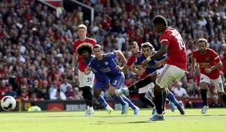 Manchester United's Marcus Rashford scores his side's first goal of the game from the penalty spot during the English Premier League soccer match between Manchester United and Leicester City at Old Trafford Stadium, Manchester England. Saturday, Sept. 14 2019 (Martin Rickett/PA via AP)