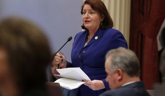 California state Senate President Pro Tem Toni Atkins, of San Diego, speaks on the floor of the Senate in Sacramento, Calif., Friday, Sept. 13, 2019. Atkins is backing a measure, that if approved, could blunt some of the Trump administration efforts to weaken federal environmental laws by making it easier for state regulators to issue emergency regulations to keep them in place in California. (AP Photo/Rich Pedroncelli)