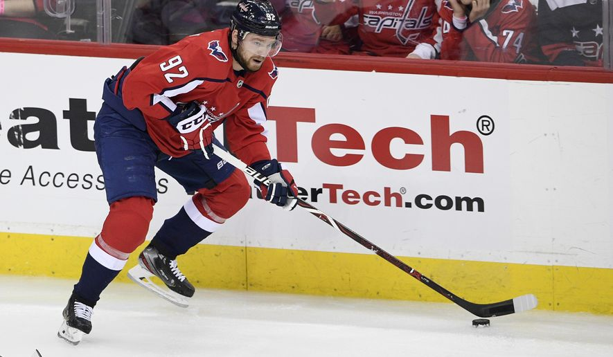 FILE - In this April 24, 2019 file photo, Washington Capitals center Evgeny Kuznetsov (92), of Russia, skates with the puck during the third period of Game 7 of an NHL hockey first-round playoff series against the Carolina Hurricanes in Washington.  Kuznetsov has been suspended without pay for three regular-season games by the NHL for inappropriate conduct, less than a month after he was banned from playing for Russia for four years because of a positive test for cocaine. The NHL announced its punishment Saturday, Sept. 14, saying it followed a meeting with Commissioner Gary Bettman on Monday. Kuznetsov will not appeal.  (AP Photo/Nick Wass, File)