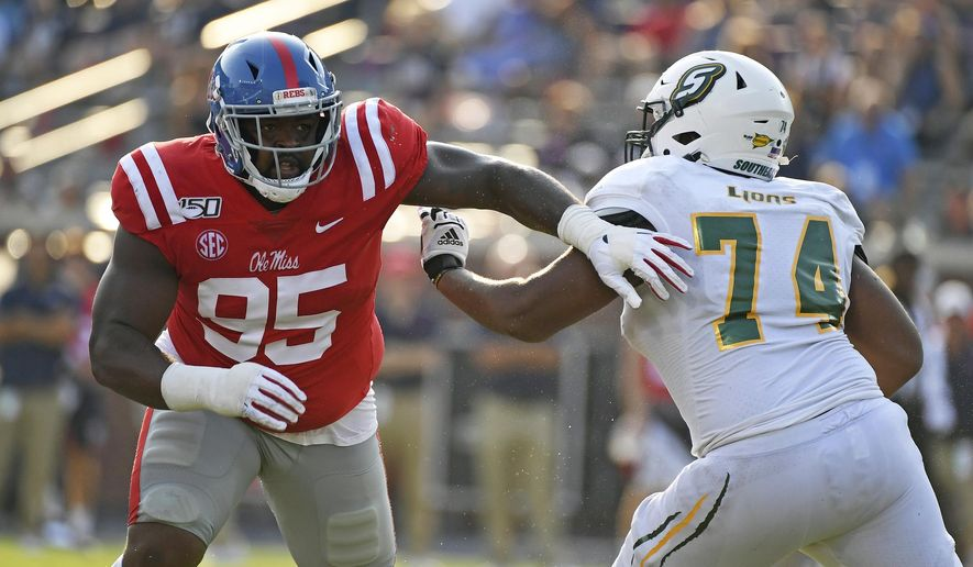 CORRECTS TO SECOND HALF - Mississippi defensive lineman Benito Jones (95) is blocked by Southeastern Louisiana offensive lineman Jarius Gooch (74) during the second half of an NCAA college football game in Oxford, Miss., Saturday, Sept. 14, 2019. Mississippi won 40-29. (AP Photo/Thomas Graning)
