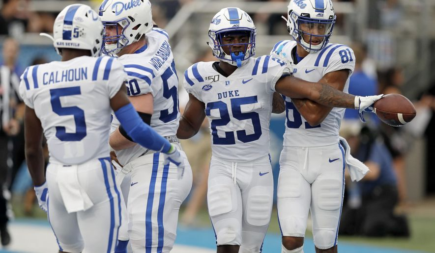 Duke running back Deon Jackson (25) is congratulated after scoring a touchdown against Middle Tennessee in the first half of an NCAA college football game Saturday, Sept. 14, 2019, in Murfreesboro, Tenn. (AP Photo/Mark Humphrey)