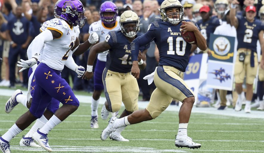 Navy quarterback Malcolm Perry runs in the first half of an NCAA college football game against East Carolina  Saturday, Sept. 14, 2019,  in Annapolis, M.D.  (Paul W. Gillespie/The Baltimore Sun via AP)