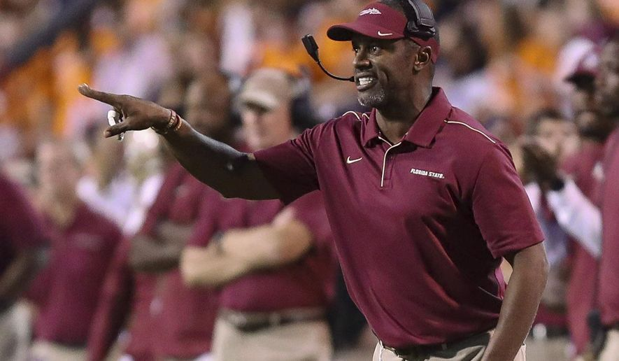 Florida State coach Willie Taggart reacts to a call during the second half of an ACC college football game against Virginia in Charlottesville, Va., Saturday, Sept. 14, 2019. (AP Photo/Andrew Shurtleff)