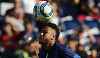 PSG's Neymar plays with the ball ahead of the the French League One soccer match between Paris Saint Germain and Strasbourg at the Parc des Princes Stadium in Paris, France, Saturday Sept.14, 2019. (AP Photo/Francois Mori)