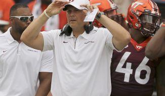 Virginia Tech head coach Justin Fuente watches before an NCAA college football game against Furman, Saturday, Sept. 13, 2019, in Blacksburg Va. (Matt Gentry/The Roanoke Times via AP)