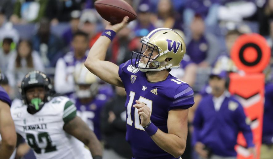 Washington quarterback Jacob Eason passes against Hawaii during the first half of an NCAA college football game, Saturday, Sept. 14, 2019, in Seattle. (AP Photo/Ted S. Warren)