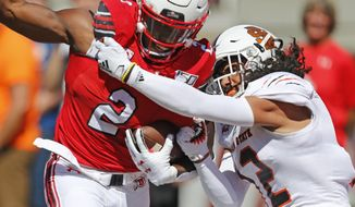 Utah running back Zack Moss (2) is tackled by Idaho State defensive back Adkin Aguirre (12) in the first half of an NCAA college football game Saturday, Sept. 14, 2019, in Salt Lake City. (AP Photo/Rick Bowmer)