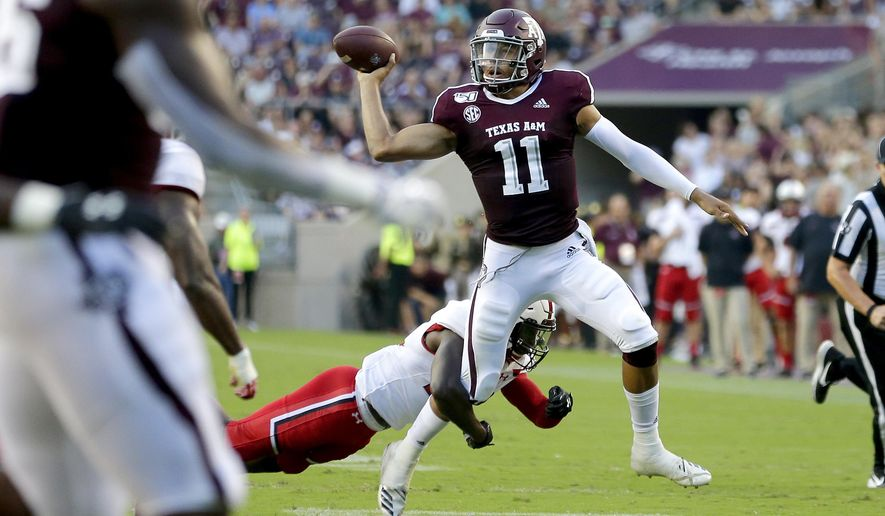 Texas A&M quarterback Kellen Mond (11) looks to pass as Lamar defensive back Andre Mulinax (22) applies pressure during the first half of an NCAA college football game, Saturday, Sept. 14, 2019, in College Station, Texas. (AP Photo/Sam Craft)
