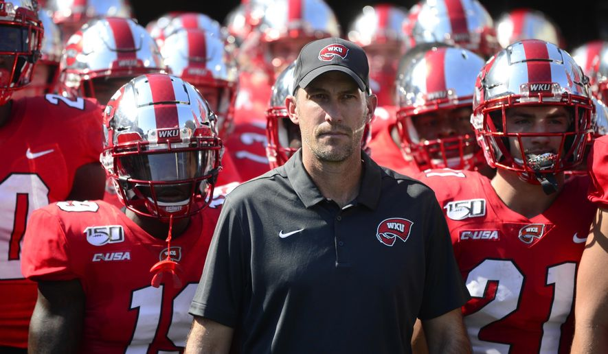 Western Kentucky head coach Tyson Helton prepares to lead his team out to the field at the start of an NCAA college football game against Louisville, Saturday, Sept. 14, 2019, in Nashville, Tenn. (AP Photo/Mike Strasinger)