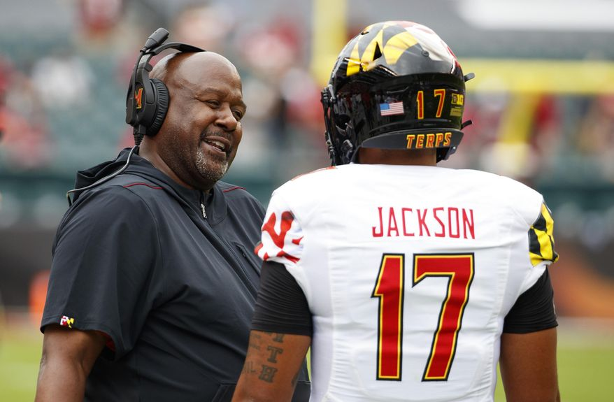 Maryland head coach Michael Locksley, left, talks things over with quarterback Josh Jackson (17) during the first half of an NCAA college football against Temple, Saturday, Sept. 14, 2019, in Philadelphia. (AP Photo/Chris Szagola) ** FILE **
