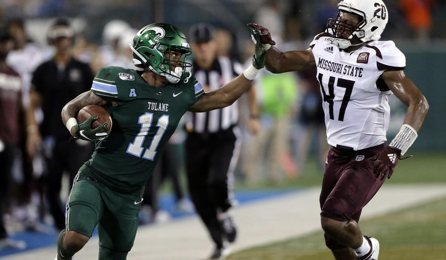 Tulane running back Amare Jones (11) fights his way past Missouri State safety Kam Carter (47) for a long gain during an NCAA college football game Saturday, Sept. 14, 2019, in New Orleans. (A.J. Sisco/The Advocate via AP)