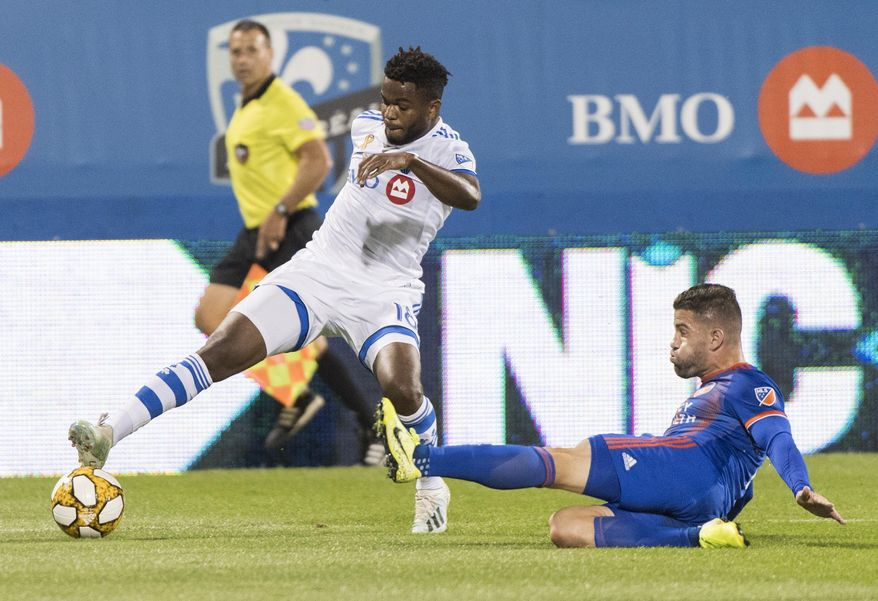 Montreal Impact's Orji Okwonkwo, left, challenges FC Cincinnati's Greg Garza during the first half of an MLS soccer match Saturday, Sept. 14, 2019, in Montreal. (Graham Hughes/The Canadian Press via AP)
